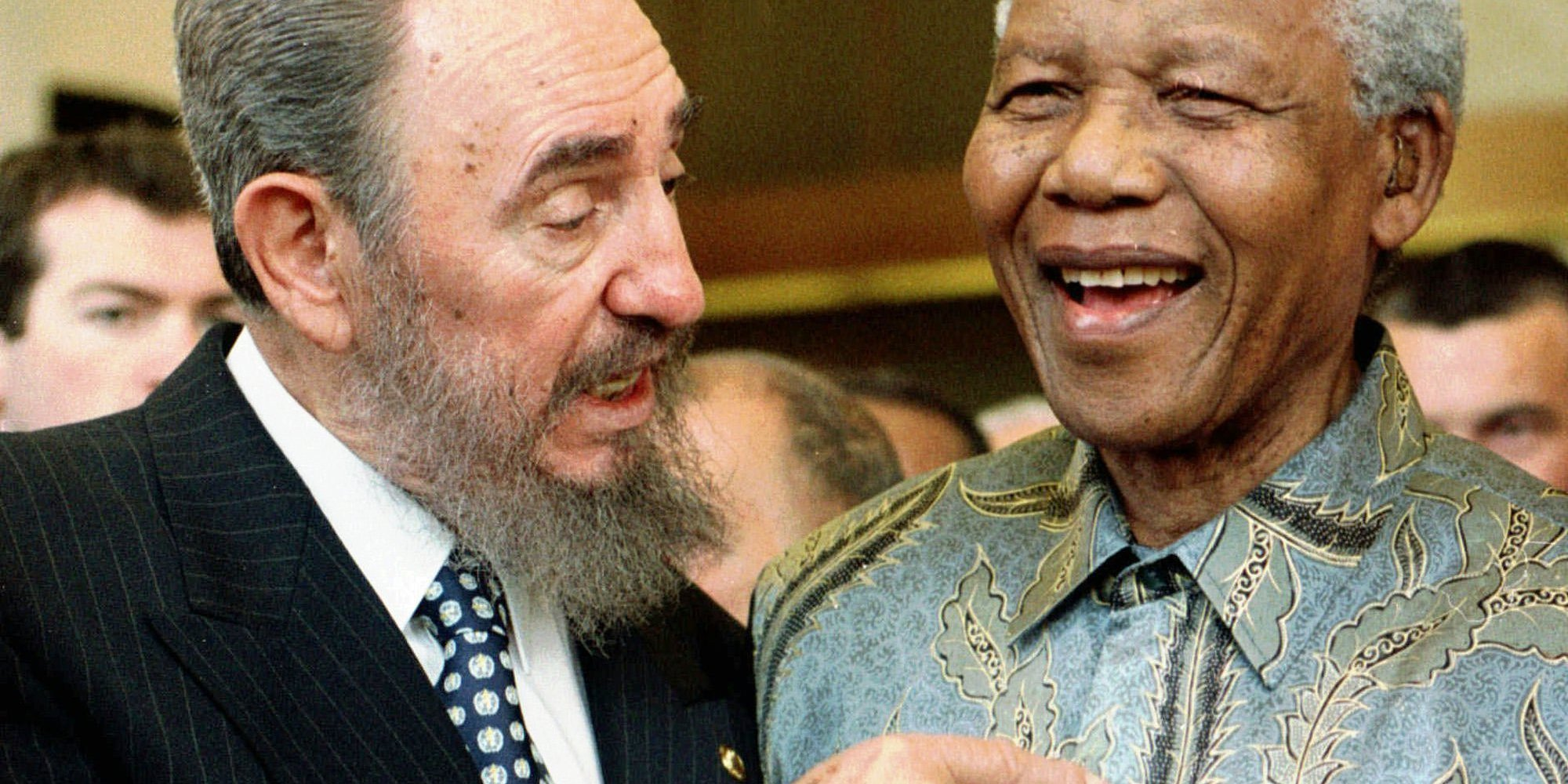 Cuban leader Fidel Castro, left, shares a laugh with South Africa President Nelson Mandela at the World Trade Organization held in Geneva Tuesday, May 19, 1998. Mandela and Castro said in separate speeches that the global trading system had failed to achieve its goals of bringing a higher standard of living to many developing countries. (AP Photo/PATRICK AVIOLAT)